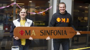 Members of Sinfonia hold their paddle in Mund
