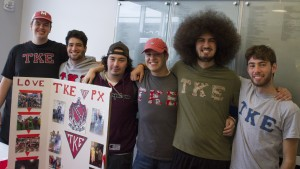 Members of the Tau Kappa Epsilon (TKE) fraternity host a table in Mund