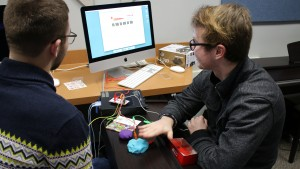 Music Education students work with Makey Makey product to create sound using bananas, cucumbers, PlayDoh, and tin foil