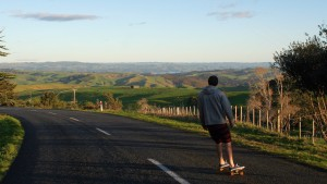 Digital Communications student Alex Bushong skateboards near Ragland New Zealand