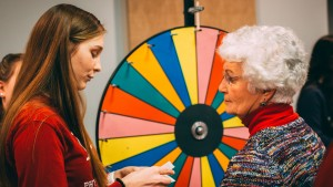 A Students helping Seniors club member speak with a resident of Londonderry Village