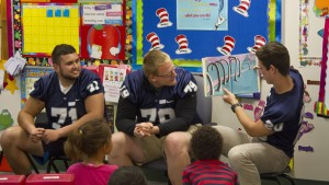 The LVC football team reads to the students of Henry Houck Elementary School in Lebanon, Pa.