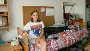A student poses in her dorm room at LVC