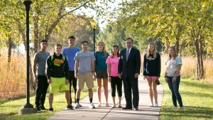 President Lewis E. Thayne stands with students at Lebanon Valley College