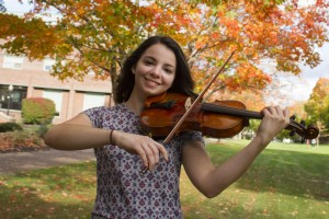 Alyssa Lahoda poses with her violin on the quad at Lebanon Valley College