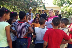 Anna Quinn works with children during a international service trip