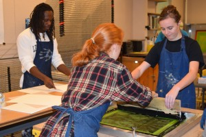 Art students work on a printing project