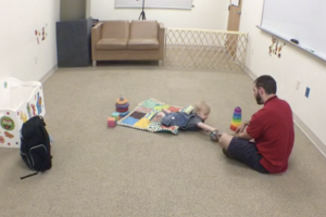 A father plays with his child in the Baby Lab at Lebanon Valley College