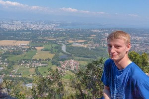 Physics and mathematics major Justin Cammarota poses in Geneva during his internship at CERN