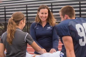 Athletic trainer Erin Ulrich takes care of a student-athlete on the sidelines at Lebanon Valley College
