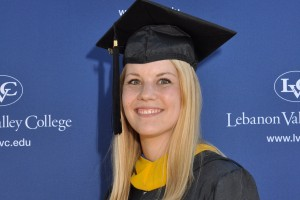 Digital Communications major Kayla Fulfer poses for her Commencement photo