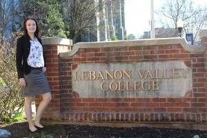 Jasmine Olvany poses with the Lebanon Valley College sign