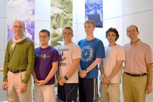 Dr. David Lyons and Dr. Scott Walck pose with students from the Math Physics Research Group at Lebanon Valley College