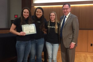Students Helping Seniors accepts the President's Service Award from LVC President Lewis E. Thayne