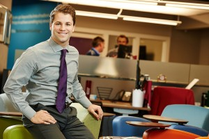 Ryan Derfler poses in an office