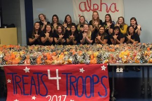 Alpha Sigma Tau members assemble treat bags for troops at Lebanon Valley College