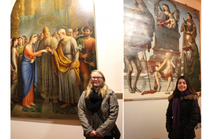 Art majors Audrey Reiley and Sarah Johnson pose in front of artwork in Italy