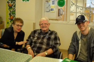 LVC student Travis Hall talks with a veteran and his wife at the Lebanon VA Medical Center.