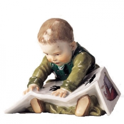 Child Seated with Picture Book