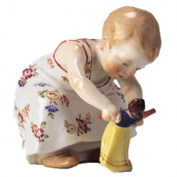 Child Crouching with Doll In Hands