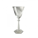 Baccarat Arcade Red Wine Goblet Since 1764, when King Louis XV gave the Bishop de Montmorency-Laval of Metz permission to found a glassworks in the town of Baccarat in Lorraine, the name Baccarat has personified a certain image of French fashion and culture. It started as a simple glassworks producing windowpanes, mirrors, and everyday drinkware, until 1816 when the first crystal oven went into operation. Over 3,000 people worked at the manufactory by this time.