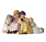 Four Children Sitting on Bench Looking at Doll