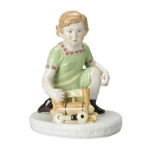Child with Locomotive Figurine
