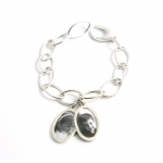 Monica Rich Kosann Sterling Oval Ring Bracelet Monica Rich Kosann is a museum and gallery exhibited fine art photographer specializing in creative, black and white portraiture.