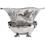 Audobon Dreaming Sterling Silver Vase A mallard takes flight into a sky hoisted on the backs of turtles and embraced by frogs. A spectacular wildlife reverie in sterling. Handcrafted repouss�. Truly fantastic.
