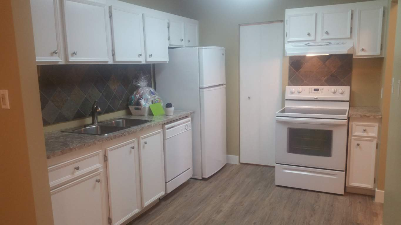 New floors and counter tops. Dishwasher included