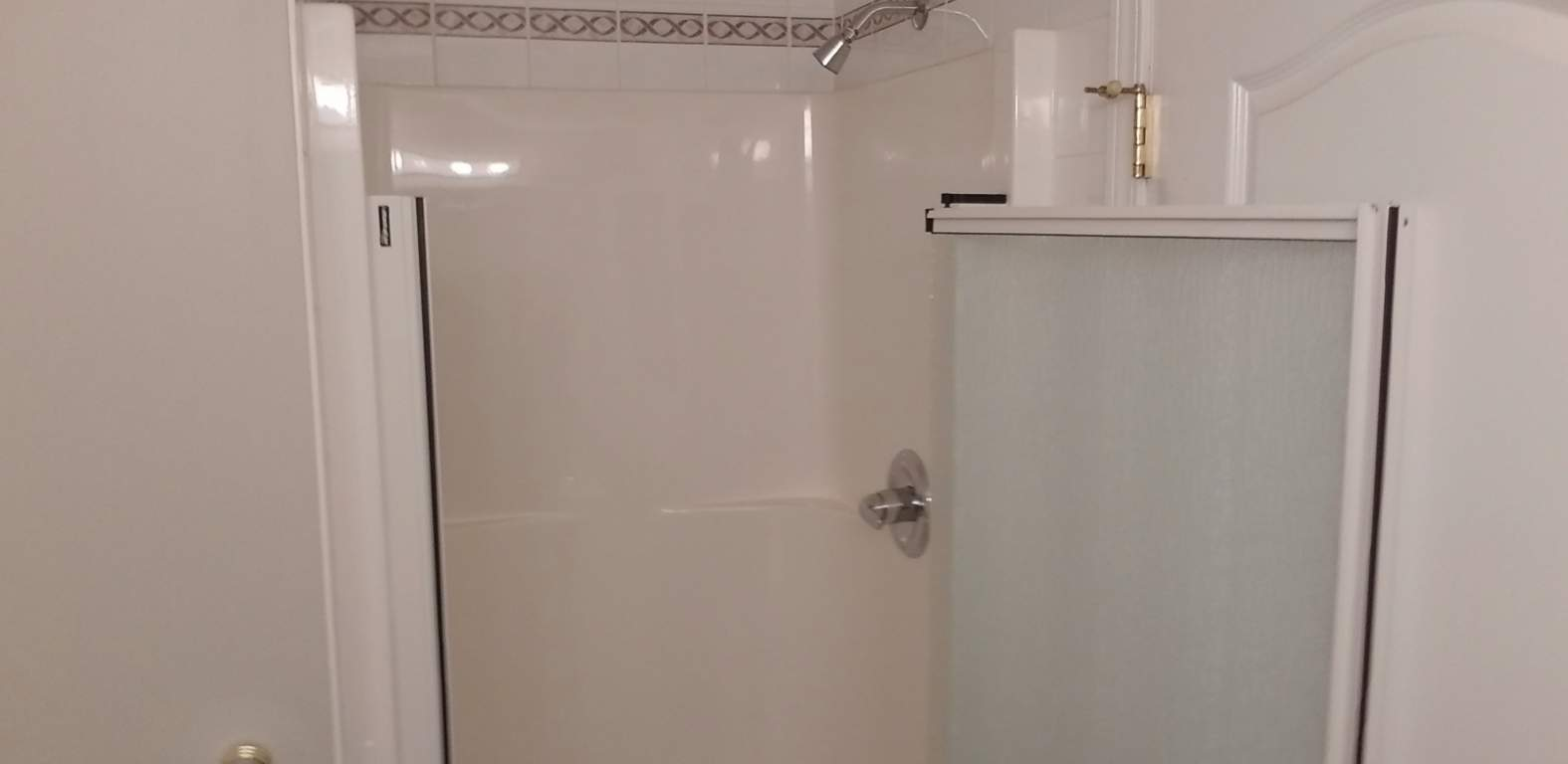 Ensuite bath includes separate shower with low step height easy access shower