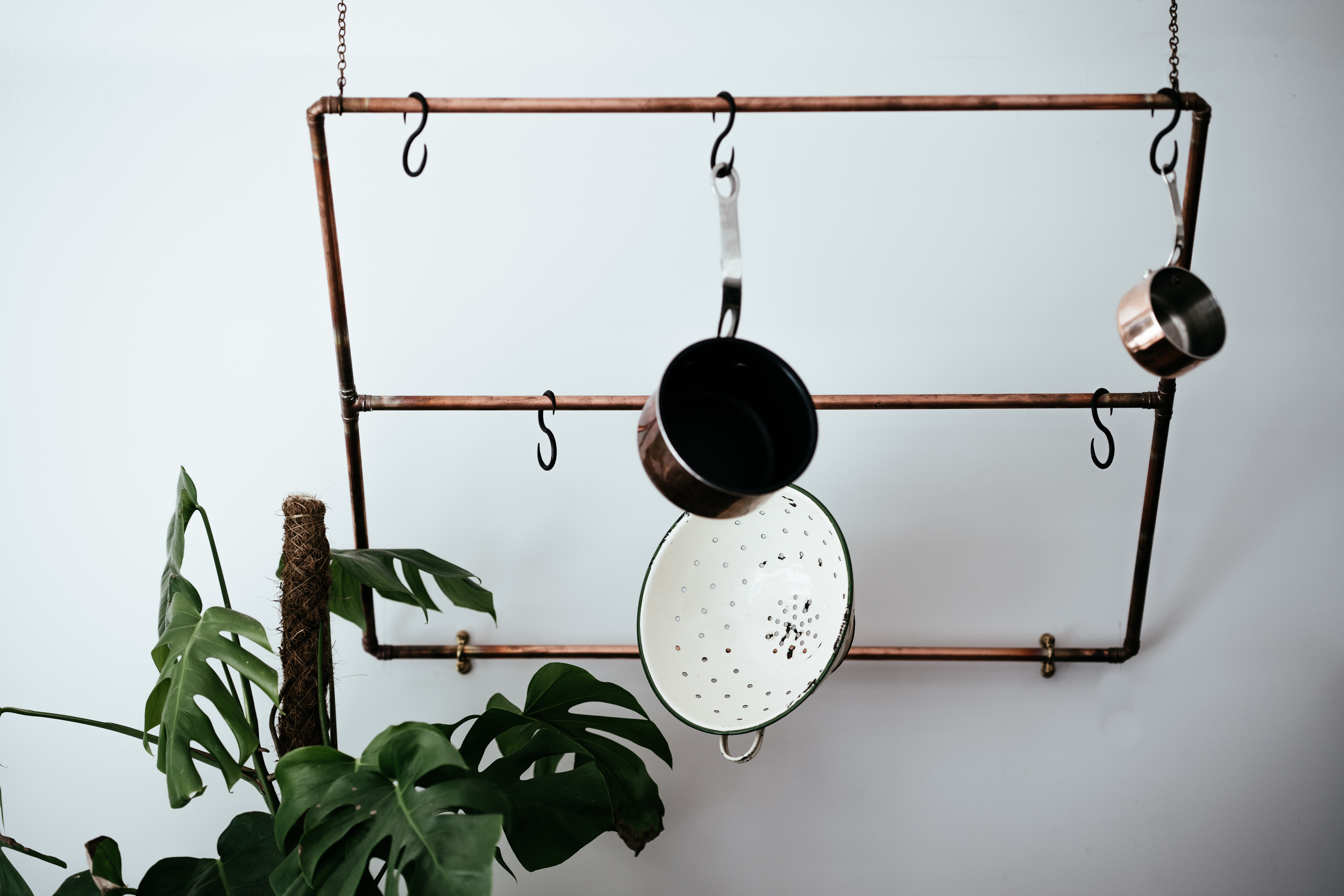 Hanging pots and pans to reduce clutter