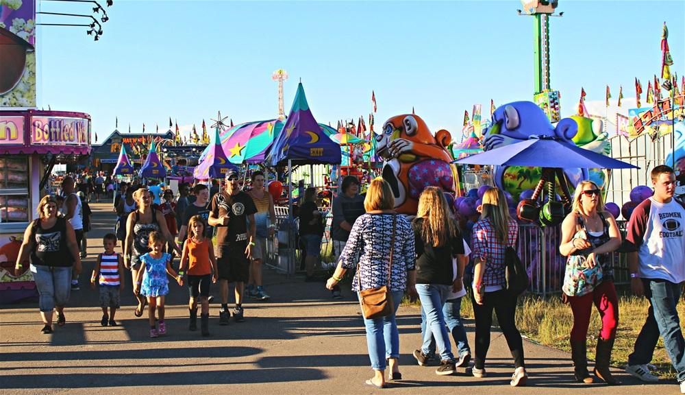 People walking around during the Medicine Hat Exhibition & Stampede