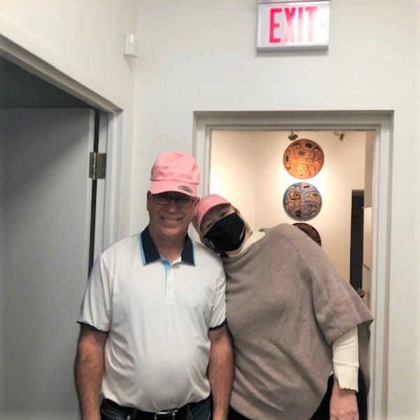 Greenrock staff members wearing pink hats
