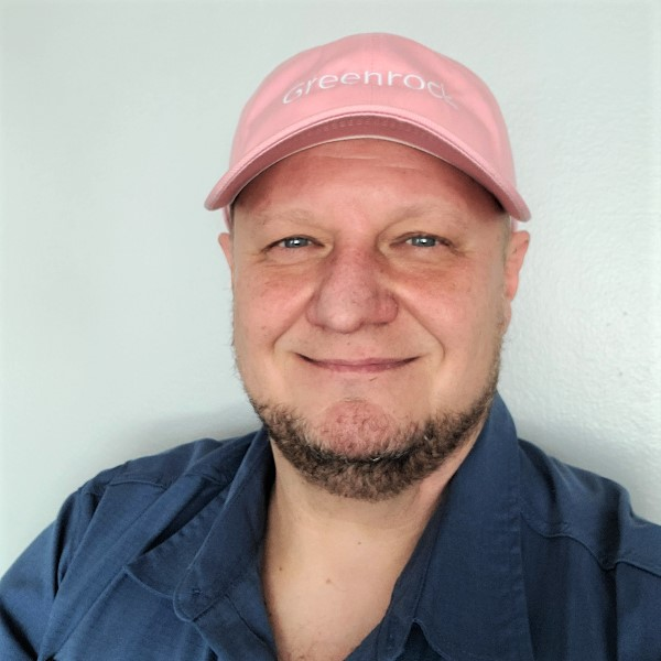 Greenrock staff wearing pink hat