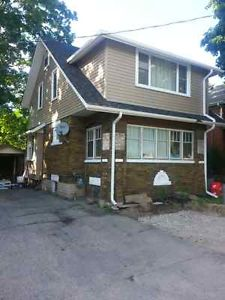 HUGE fenced mature treed yard! Walk to King St and Belmont Village! Two levels of house!