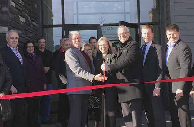 Ron Fawcett, Minister Polak and Jack Froese cut the ribbon for Lexington Court