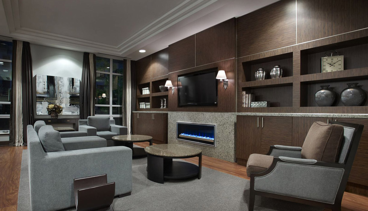 KG Harrison Luxury Amenities Party Room Lounge with Fireplace and Free WiFi