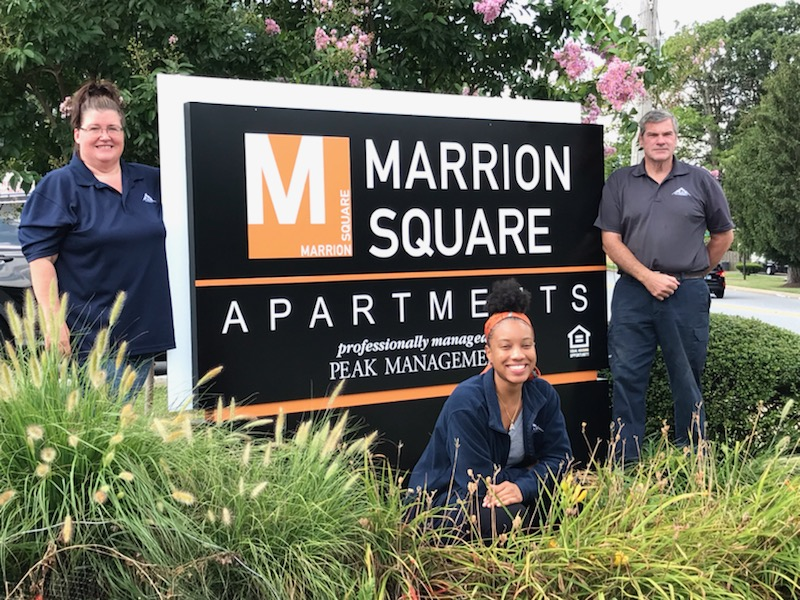 Leasing & maintenance team at Marrion Square Apartments in Pikesville, MD