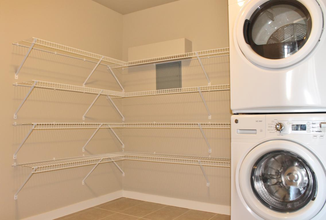 In-suite laundry room with front loading washer and dryer