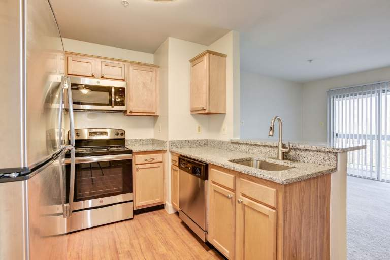 New kitchens with granite counters & stainless-steel appliances at Fox Run Apartments in Edgewood, MD