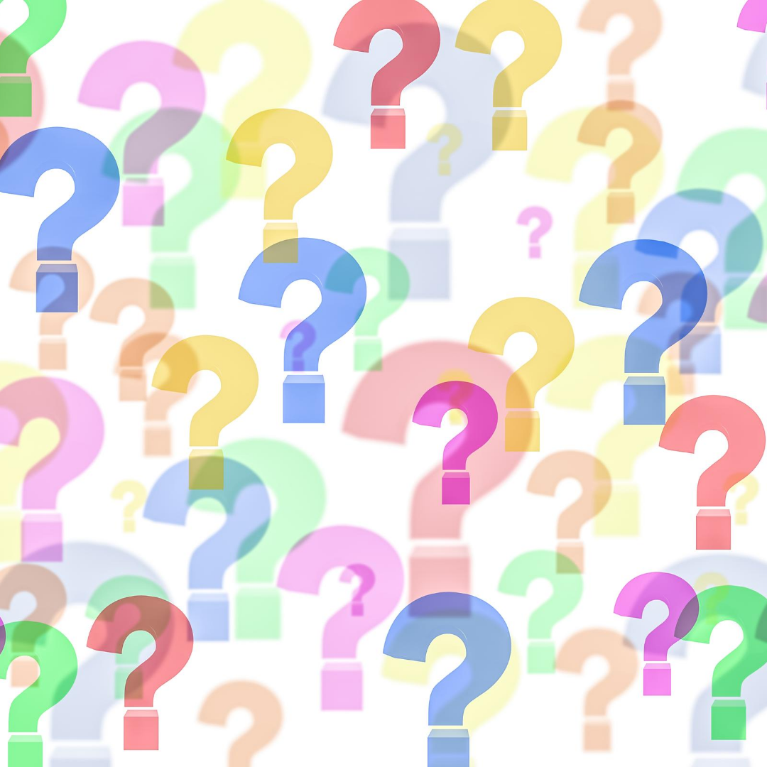 Multi-colored question marks on a white background