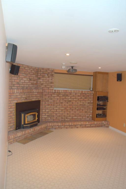 Finished Recreational room with fireplace