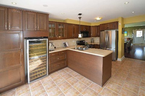 Kitchen, with wine bar, walk out to deck