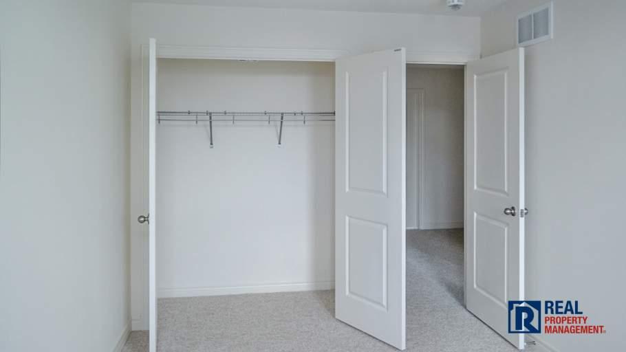 double closet in 3rd bedroom