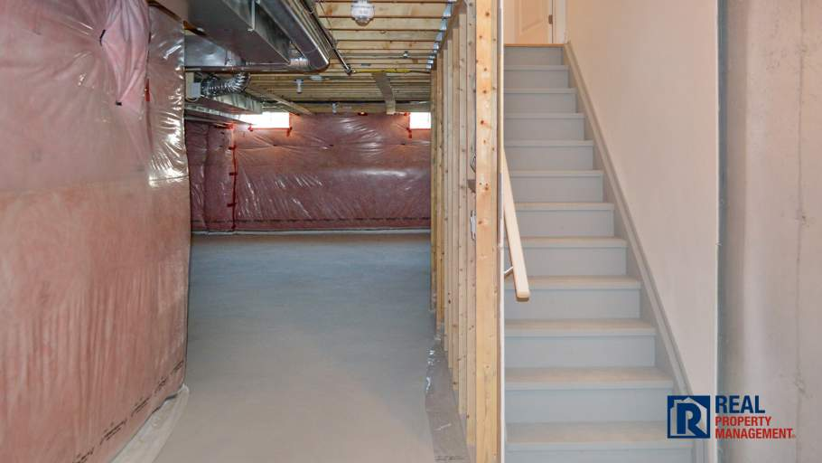 unfinished basement with cold room