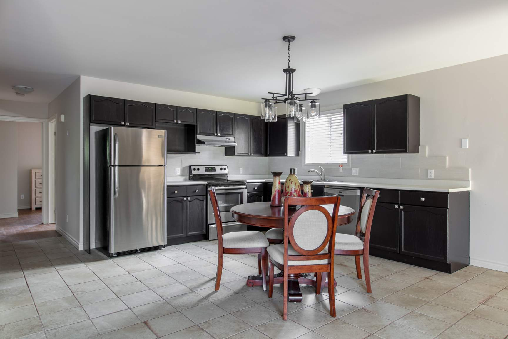 Eat in kitchen with stainless appliances and dishwasher.