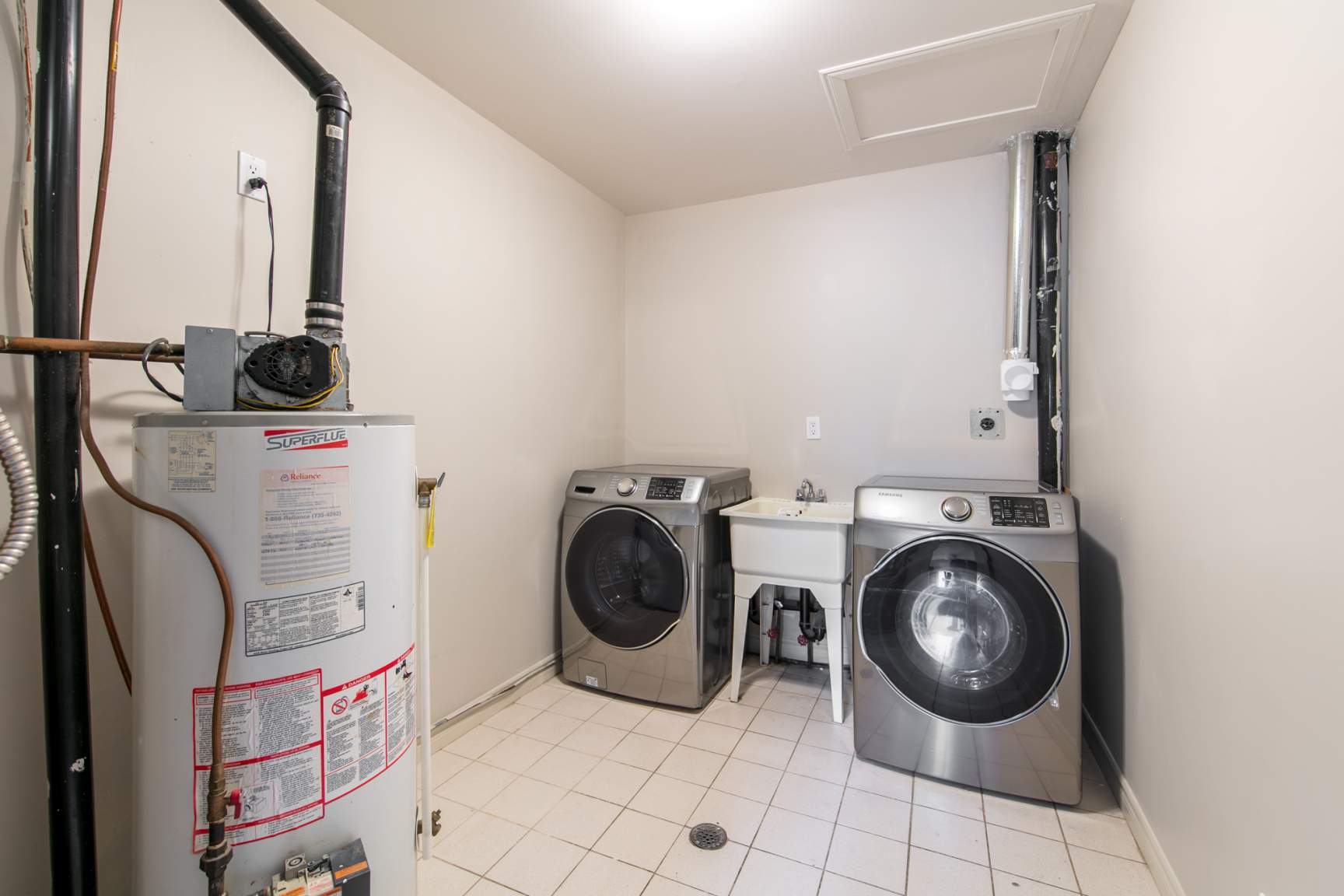 Laundry and storage room. New front load washer and dryer.