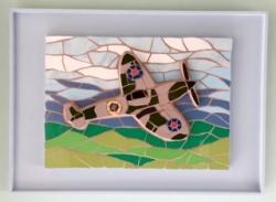 A mosaic 3D Spitfire framed wall hanging