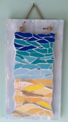 Coastal mosaic sea scene with driftwood, on distressed board with rope hanging